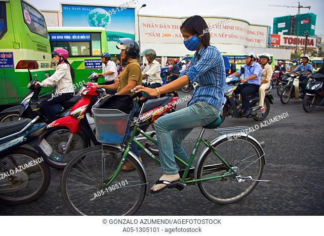 People in bicicle. Ho Chi Minh City (formerly Saigon). South Vietnam