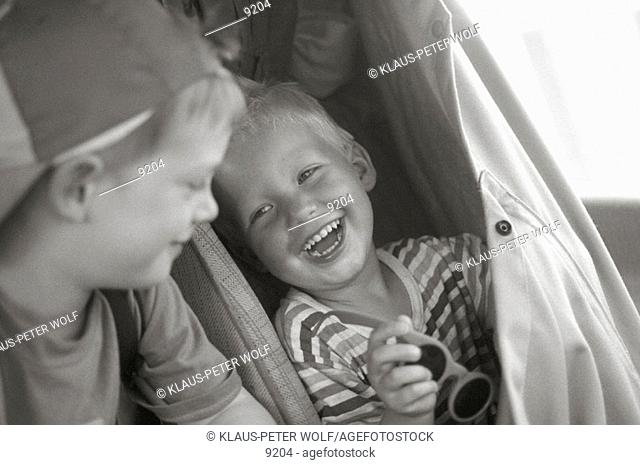 Two boys having fun in their inside of camping car