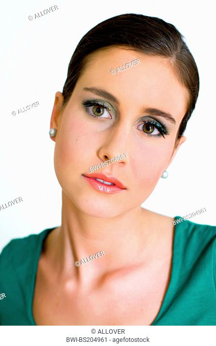 attractive young brownhaired woman looking reproachfully