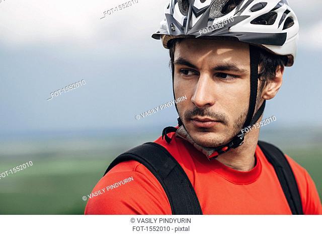 Portrait of confident man wearing bicycle helmet