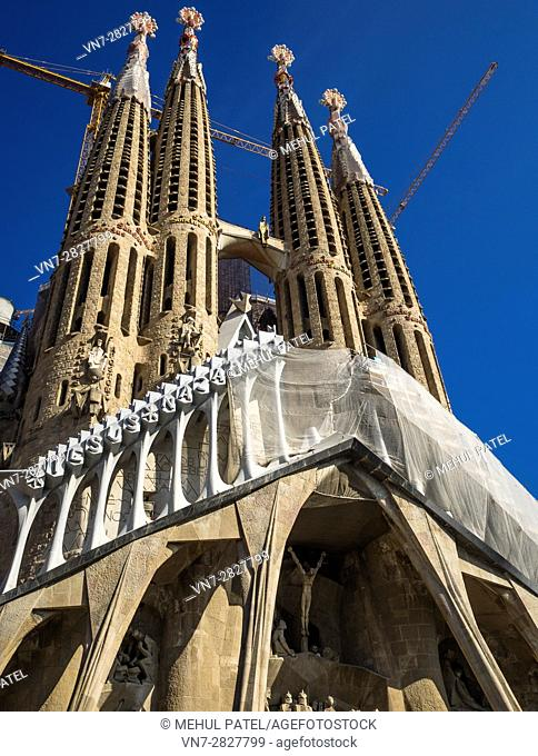 The Passion facade of La Sagrada Familia (the Church of the Holy family) - Barcelona, Catalonia, Spain. This iconic landmark of the city of Barcelona designed...