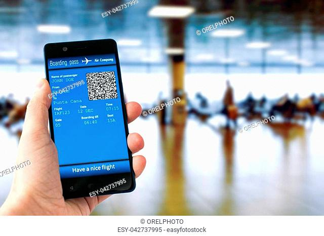 Electronic boarding pass on the screen of smartphone. Concept of modern travel