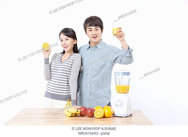 Young smiling couple with juice