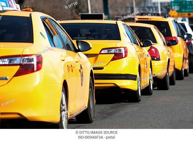 Line of yellow cabs, New York City, USA