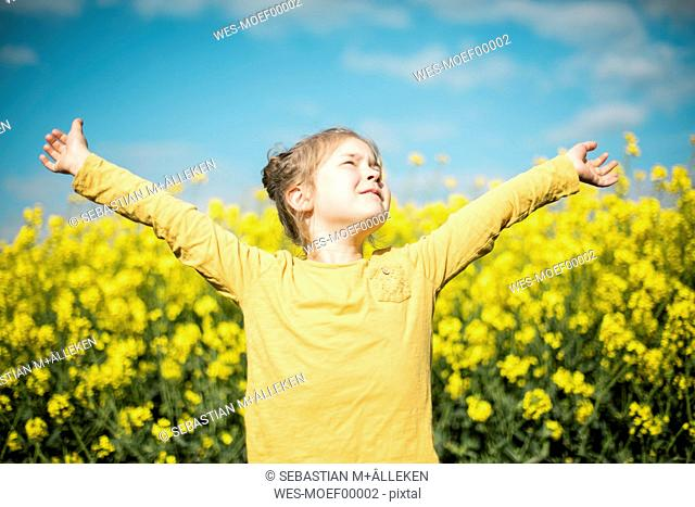 Carefree girl in rape field