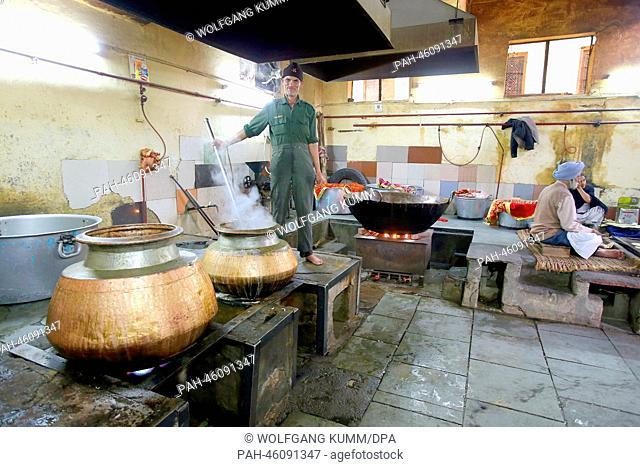A man prepares food in the great kitchen at the Gurudwara Sis Ganj Sahib Sikh tempel during a tour of New Dehli, India, 05February 2014