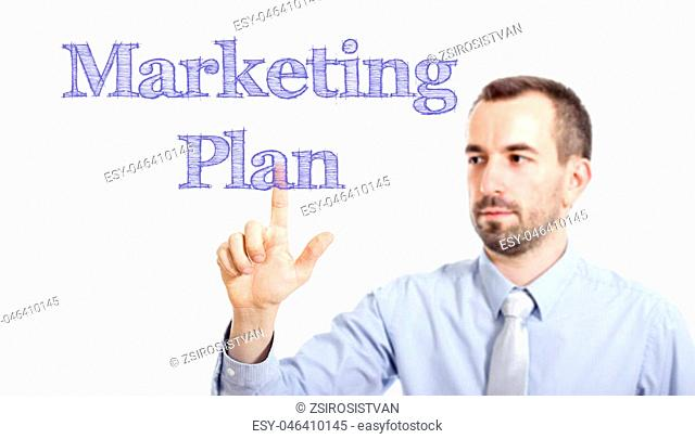 Marketing Plan Young businessman with small beard touching text - horizontal image