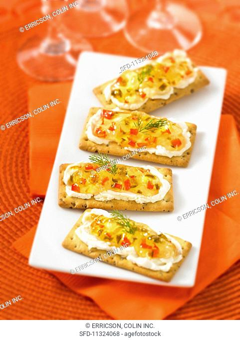 Crackers with cream cheese and chilli jam