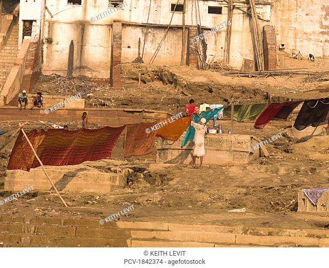The Ganges,Varanasi,India,Woman hanging her saris to dry on the ghats by the river
