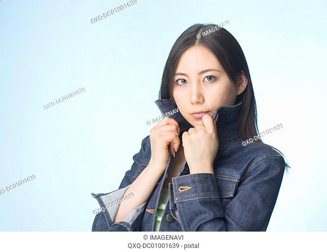 Woman adjusting shirt collar