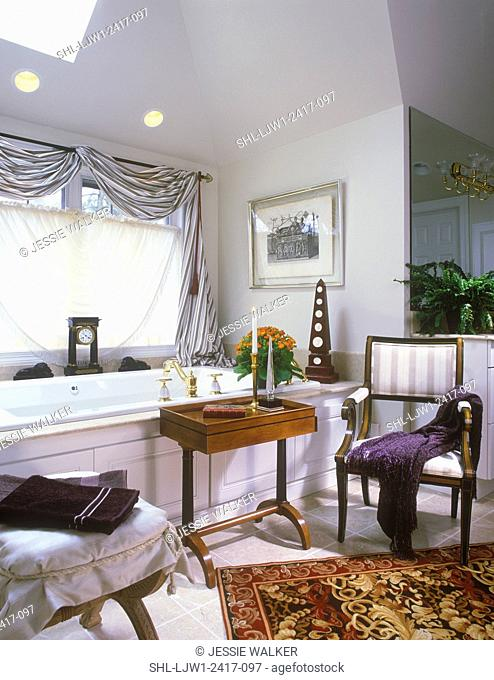 BATHROOMS - Highly styled room, focus around the tub, arm chair and table, draped scarf window treatment, skylight, french feel, area rug, tile floor, obelisk
