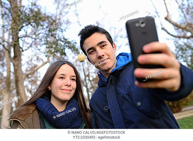 Teenagers taking a selfie in park