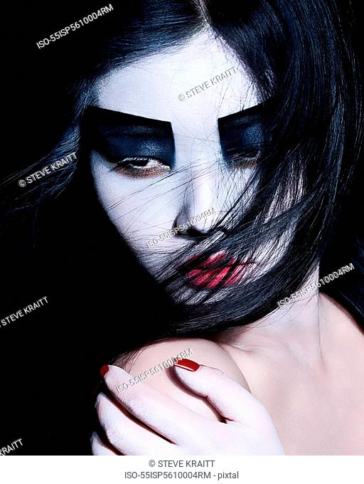 Young woman with dramatic makeup, black eyeshadow