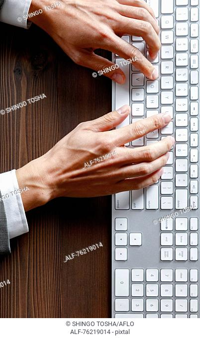 Male hands working on keyboard