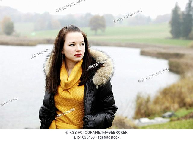 Young woman in an autumnal setting, fashion shoot