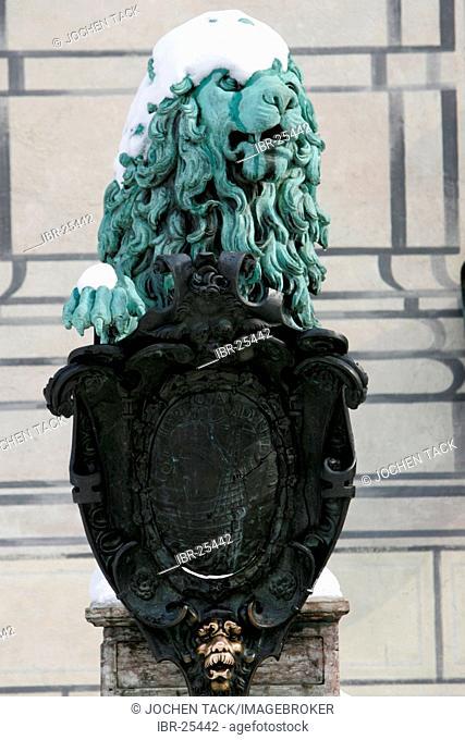 DEU, Germany, Munich : Snow covered Lion statue at the Residenz near the Hofgarten