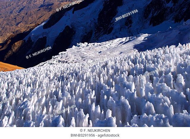 field of penitentes and crevasses at Illimani, Bolivia, Andes