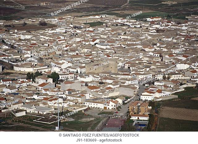 Aerial view of the city of Orgaz with a castle just at its center. Toledo province. Spain