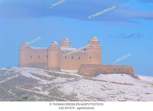 Snow-covered Renaissance castle of Lacalahorra. Granada province, Andalusia, Spain