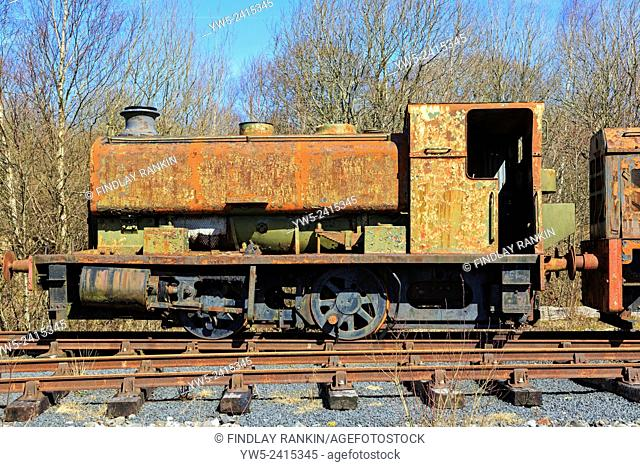 Rusting, disused and abandoned industrial tractive train parked on a siding, Ayrshire, Scotland, UK