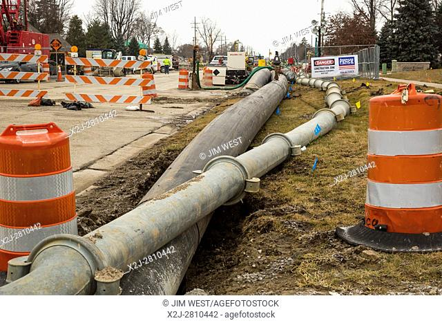 Fraser, Michigan - The collapse of an 11-foot-wide underground sewer line threatens environmental problems for 11 communities in suburban Detroit