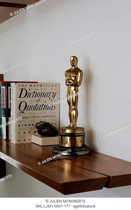 Oscar statue on wooden shelf