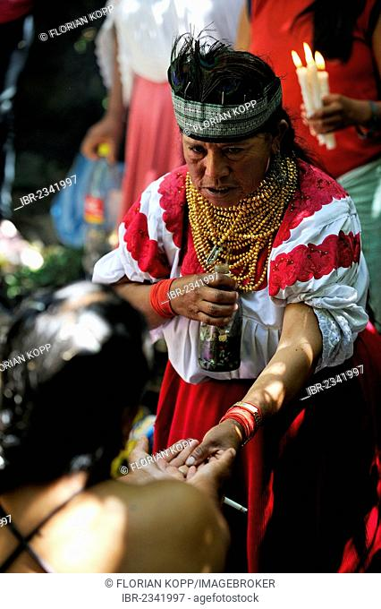 Healer, wise woman, during traditional ablutions to ward off evil spirits and to cleanse the soul of the indigenous Caranqui people