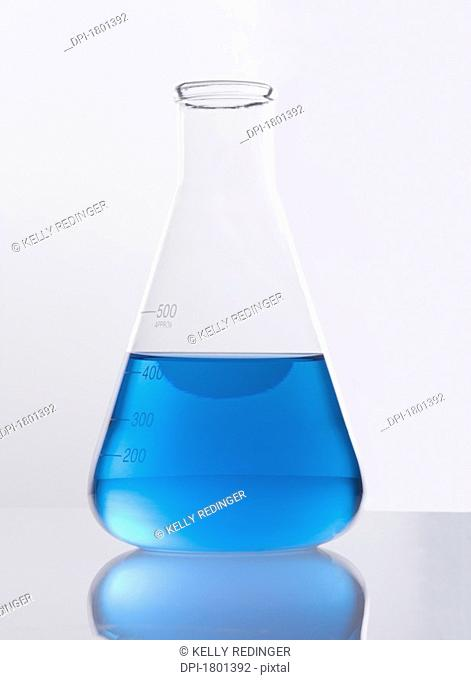 Single glass flask with blue solution