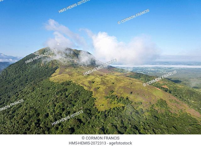France, Puy de Dome, Orcines, Chaine des Puys, Regional Natural Park of the Auvergne Volcanoes, the Puy de Dome in the clouds (aerial view)