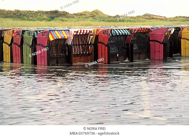 Germany, Schleswig-Holstein, island Amrum, wicker beach chairs, flood Europe