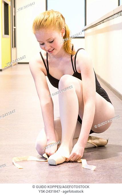Den Bosch, 's-Hertogenbosch, Netherlands. Teenage schoolgirl practising classical ballet at a local balletstudio