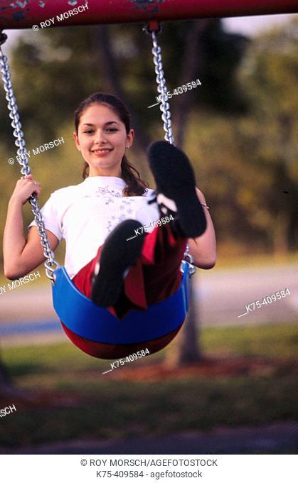 Teen on swing