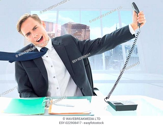 Composite image of businessman shouting as he holds out phone