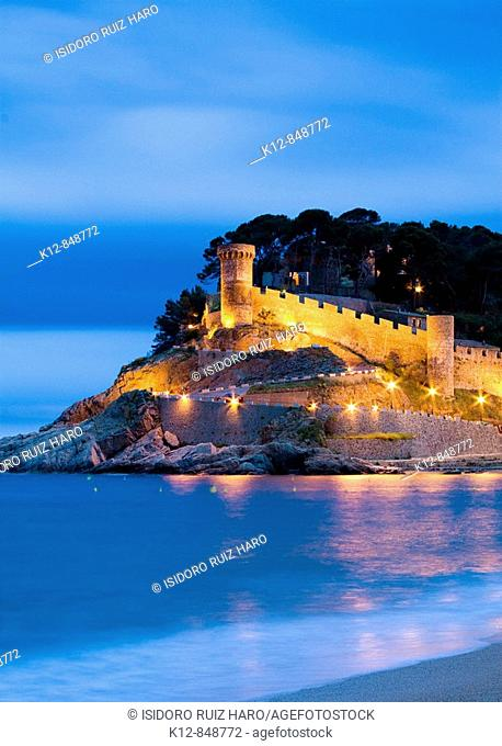 Illuminated Walls of Tossa de Mar at night. (Costa Brava). La Selva. Girona Province. Catalonia. Spain