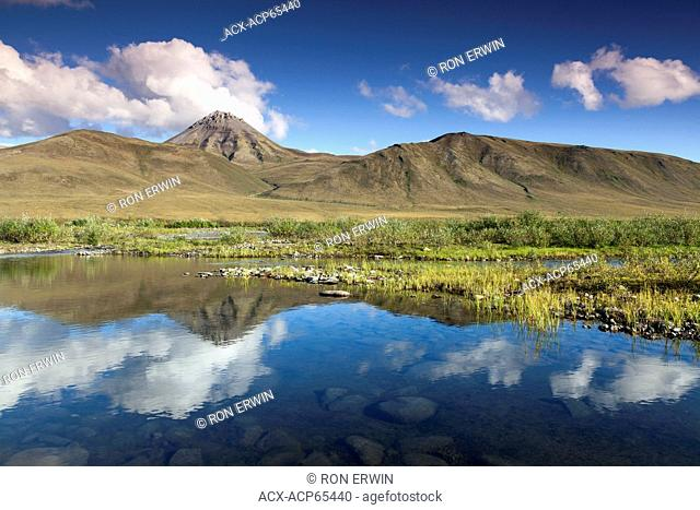 The Blackstone Uplands reflected in the Blackstone River in Tombstone Territorial Park, Yukon Territory, Canada
