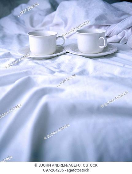 Cups of coffee in bed