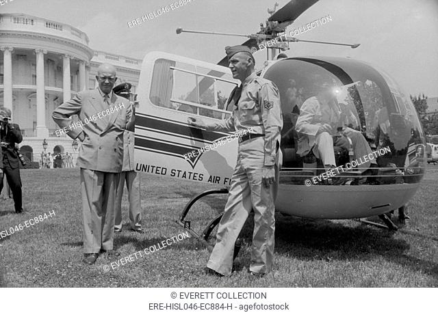 Dwight Eisenhower takes the first Presidential helicopter ride, July 1957. He is about to enter the HMX-1 Nighthawk on the White House south lawn...