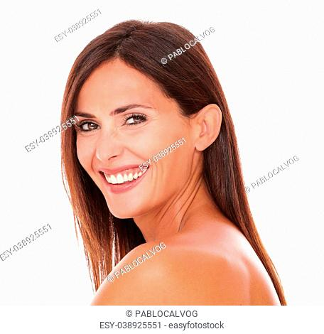 Head and shoulders portrait of happy adult woman laughing and looking at camera on isolated white background