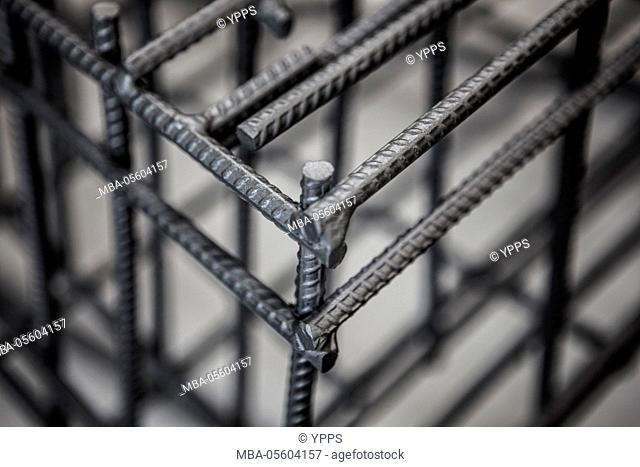 Welded iron bars form a cube
