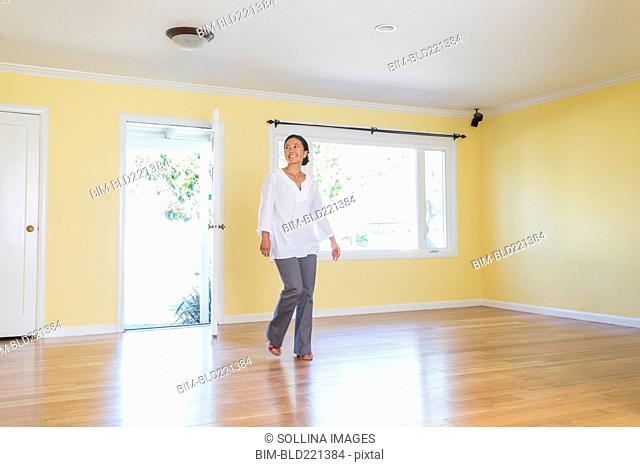 Woman admiring new home