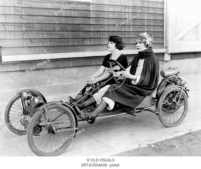 Two women in go kart All persons depicted are not longer living and no estate exists Supplier warranties that there will be no model release issues