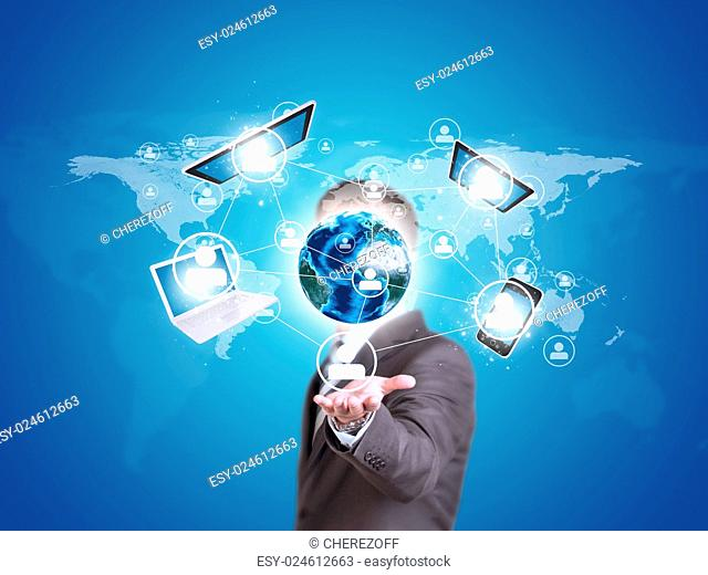 Business man hold Earth globe and electronics. Elements of this image are furnished by NASA