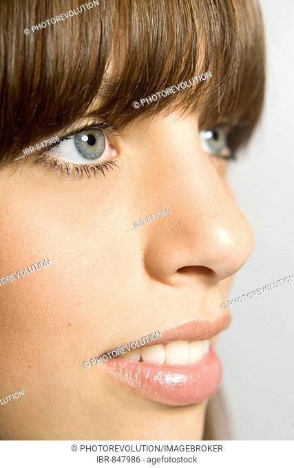Partial facial profile of a young, dark-haired woman