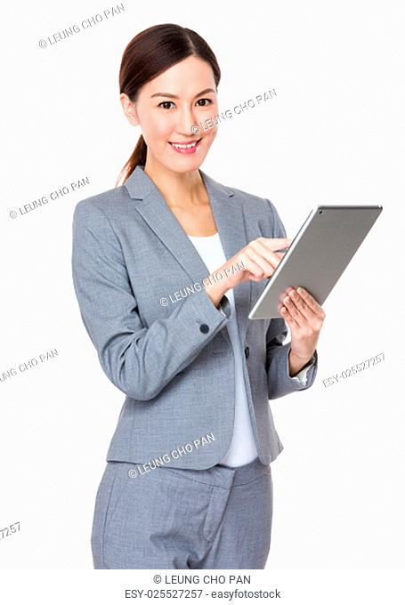 Young businesswoman touch on tablet pc