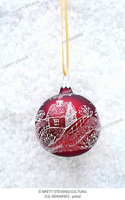 Red bauble with illustration of house