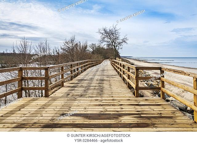 The wooden walkway is located between the Baltic Sea coast and the salt marsh. The salt moor is part of the Ecopark Wschodi (Oekopark East) a wetland with an...