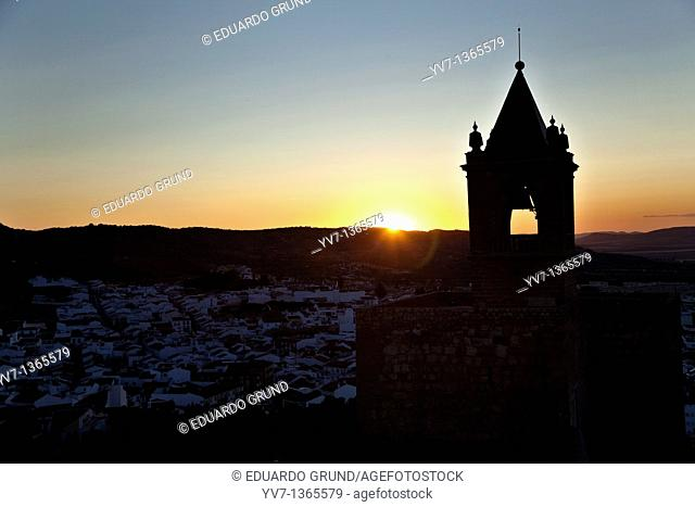 The sunset, with the Tower of Homage of the Alcazaba to the light, made from the White Tower of the Citadel of Antequera, Antequera, Andalusia, Spain
