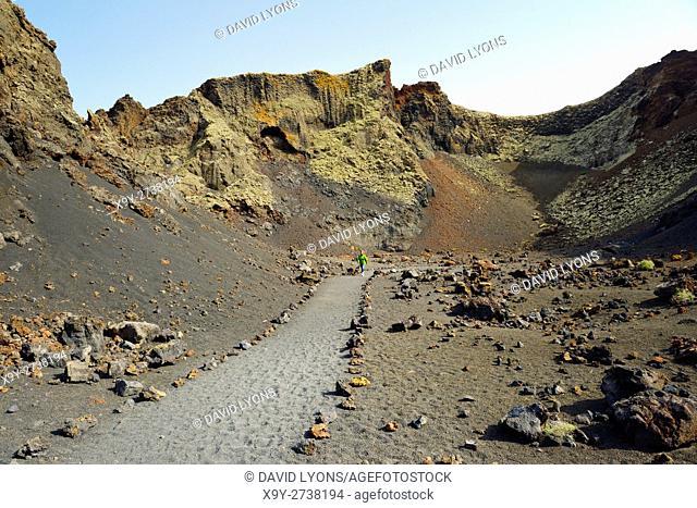 Inside the volcanic cone crater of Caldera de los Cuervos. Timanfaya National Park, Lanzarote, Canary Islands, Spain
