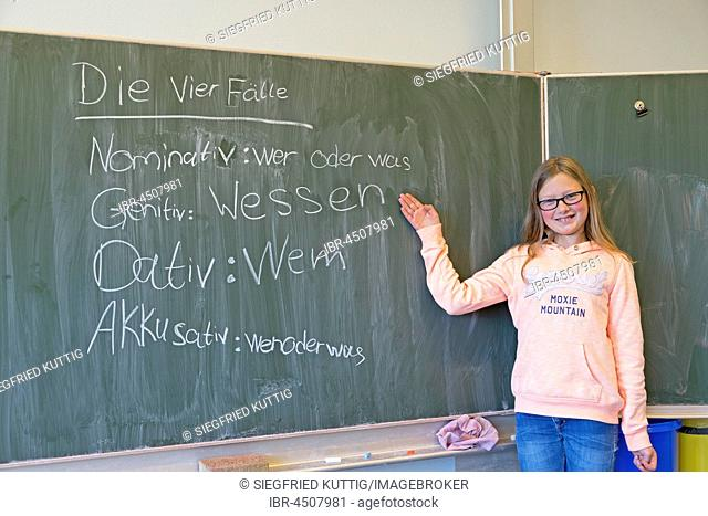 Girl at blackboard in German class, elementary school, Germany