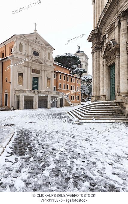 The Church of San Giuseppe dei Falegnami and Church of Santi Luca e Martina after the great snowfall of Rome in 2018